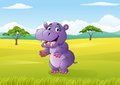Cartoon funny hippo in the jungle