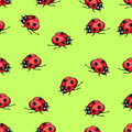 Cartoon hand drawing beetle ladybug seamless pattern, vector background. Funny insects on a green backdrop. For fabric