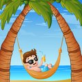 Cartoon little boy relaxing on hammock beach with a drinking cocktail Royalty Free Stock Photo