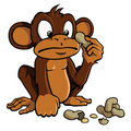 Cartoon monkey with peanuts Royalty Free Stock Image