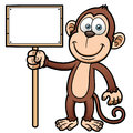 Cartoon monkey with wooden sign vector illustration of Royalty Free Stock Image