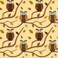 Cartoon owl on branch with autumn leaves seamless pattern background illustration vector Stock Photos