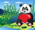 Cartoon panda holding heart outdoor Royalty Free Stock Images