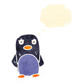 Cartoon penguin with thought bubble Royalty Free Stock Photography