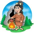 Cartoon prehistoric woman before cave Royalty Free Stock Photo