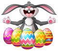 Cartoon rabbit laughing with five decorated easter eggs