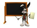 Cartoon rabbit standing in front of a blackboard. Stock Photography