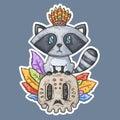 Cartoon raccoon sits on the skull.