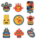 Cartoon robots and monsters faces in color vector illustration set Stock Image