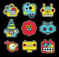 Cartoon robots and monsters faces in color vector illustration set Stock Photography