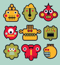 Cartoon robots and monsters faces in color vector illustration set Royalty Free Stock Photography