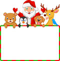 Cartoon Santa and friend with blank sign Royalty Free Stock Photo