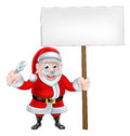 Cartoon santa holding wrench and sign a christmas of claus a spanner board Royalty Free Stock Photo