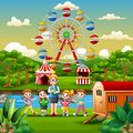 Cartoon of school children and a teacher with amusement park background Royalty Free Stock Photo