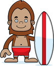 Cartoon smiling surfer sasquatch a Royalty Free Stock Photos