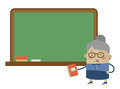 Cartoon teacher original character in front of a chalkboard Stock Photo