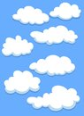 Cartoon white clouds on sky blue for design Stock Photos