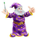 Cartoon wizard with wand a or sorcerer holding a and giving a happy thumbs up Royalty Free Stock Images