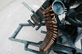 Cartridge belt of ammo at machine gun. Royalty Free Stock Photo