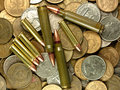 Cartridges and money. Royalty Free Stock Image