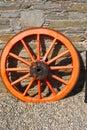 Cartwheel against a stonewall orange stone wall Stock Image