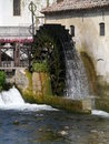 Cartwheel the carriage wheel of a water mill in portogruaro a town on the river lemene in the province venice in veneto in italy Stock Image