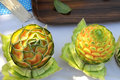 Carved Cantaloupes on a Table Stock Images