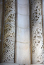 Carved columns detail of two decorating an arched doorway Stock Photo