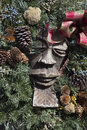 Carved figure with christmas wreath on canyon road in taos nm dressed in the holiday season Stock Images