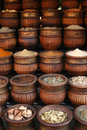 Carved handmade pots of spices, Morocco Stock Photography