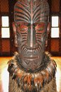 Carved interior of a Maori meeting house. Royalty Free Stock Photo