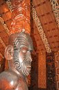 Carved interior of a Maori meeting house Royalty Free Stock Photo