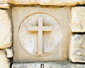 Carved out cross ceramic tile in old rock wall with holy the christian religious symbol tile is one of a series of seven Royalty Free Stock Photography