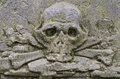 Carved skull with crossbones on the tombstone old prague cemetery czech republic europe Stock Photography