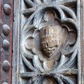 Carved stone coat of arms valencia closeup detail an old in a doorway the solid wooden door featuring iron bands and studs old Stock Images