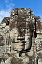 Carved stone face at bayon temple in the historic angkor wat complex Royalty Free Stock Photos