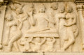 Carved stone relief showing buddha surrounded by beautiful women base of the huge buddha statue in the middle of hussain sagar Royalty Free Stock Photography