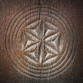 Carved symbol on ancient wood Royalty Free Stock Photo