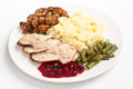 Carved turkey with mash and cranberry sauce traditional potato green beans stuffing Stock Photography