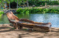 Carved wooden bench out of a monkey pod tree Royalty Free Stock Image