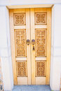 Carved wooden church door. Stock Image