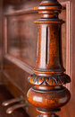 Carved wooden decoration of an old german piano detail a Stock Photo