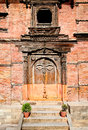 Carved wooden door on hanuman dhoka old royal palace in kathman durbar square kathmandu nepal Royalty Free Stock Image