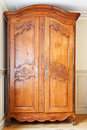 Carved wooden doors of old retro wardrobe Stock Image