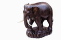 Carved wooden elephant with white tusks Stock Photography