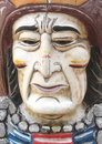Carved wooden face american indian close up of an old and painted of a north man Stock Photography