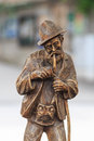 Carved wooden figure of an old full bearded resident from the alps lighting a pipe Royalty Free Stock Photography