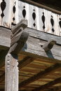 Carved wooden railing detail to rustic old house Royalty Free Stock Photo