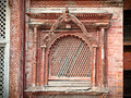 Carved wooden window on hanuman dhoka old royal palace in kathma durbar square kathmandu nepal Stock Photos