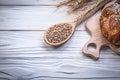Carving board wheat rye ears bread stick wooden spoon corn Royalty Free Stock Photo